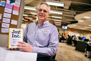 Richard Sheridan with his book Joy, Inc. at Menlo Innovations